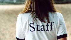 """Woman wearing """"Staff"""" shirt"""